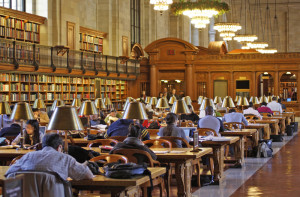People seated in the New York Public Library's Rose Reading Room